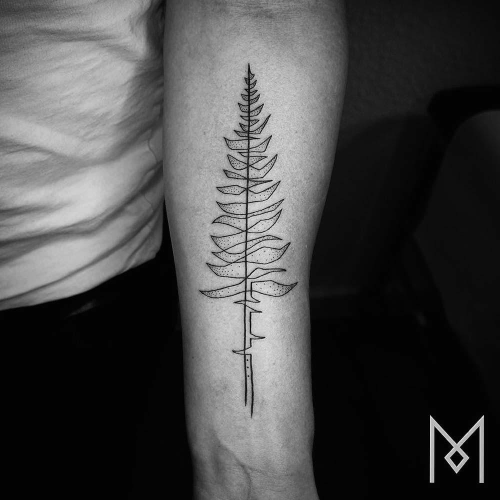 Estos asombrosos tatuajes creados usando una sola línea continua sorprenden a todo el mundo