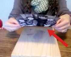 Pega una foto sobre una tabla de madera. Lo que aparece al final es absolutamente genial